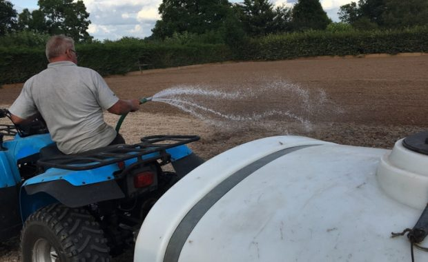 Watering an arena on a quad bike with bowser attached