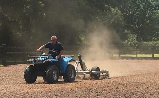 Equine arena maintenance with quad bike and harrow